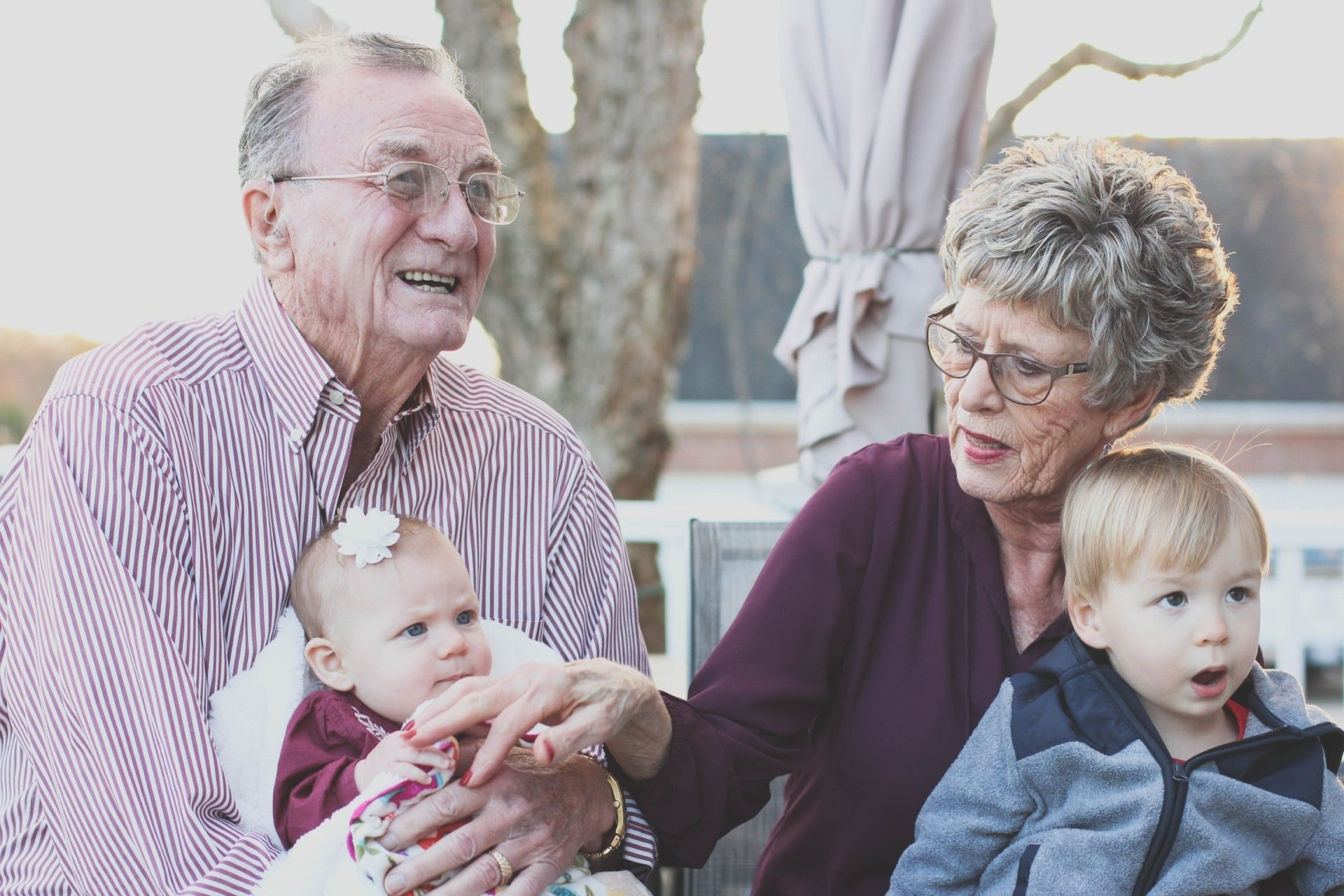 elderly couple leaving hearing aid reviews